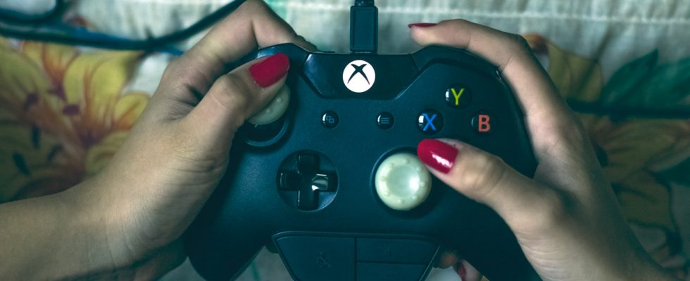 person-holding-microsoft-xbox-one-controller-1666759